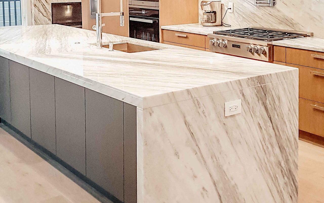 century-cabinets-custom-waterfall-quartz-countertops-made-in-a-kitchen-renovation-in-north-vancouver-2018.jpg