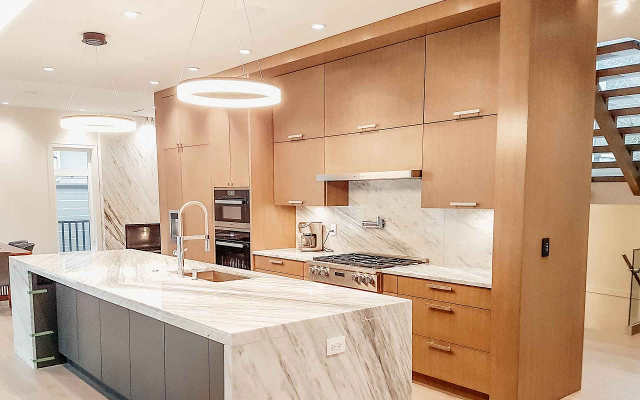 century-cabinets-n-countertops-2018-12-21_north-vancouver-renovation-kitchen-project-brown-modern-kitchen-and-waterfall-countertops.jpg